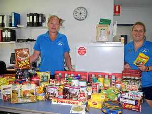 FOOD GALORE: Peita Rollings and Rebecca Woods from the Whitsunday Neighbourhood Centre with the food donated so far.