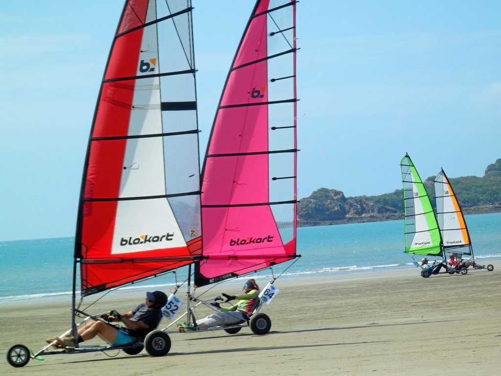 Kate Francis follows closely behind Jim Walker in a Blokart regatta race.