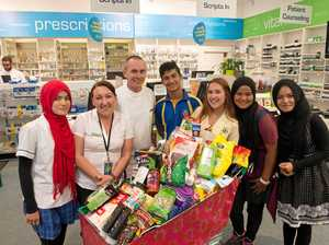 MERRY TIMES FOR DESERVING FAMILY: (left to right) Zarifa, Claudia, Michael, Murtza, Nicole, Marzia and Sadiqa.