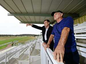 General Manager at Ipswich Turf Club Brett Kitching and president of the Ipswich Greyhound Racing Club manager Merv Page discuss plans to move the greyhound track to Bundamba.