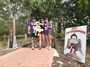 Cooper Christensen's parents Michael and Amanda thank walkers as they enter Cooper's Walk at Torquay.