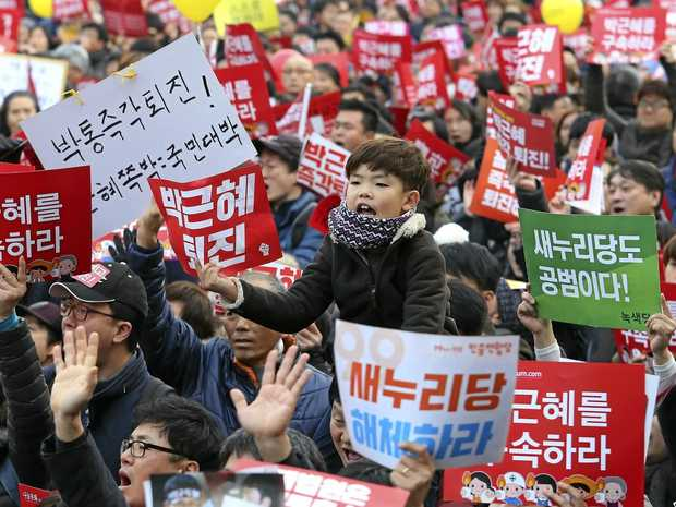 South Koreans demand arrest of scandal-hit president