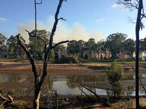 Fire burns on Burnett River island