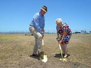 Member for Rockhampton Bill Byrne and Member for Capricornia Michelle Landry at the sod turning ceremony for the new RACQ Helicopter Rescue complex at Rockhampton Airport.