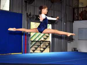 Coast gymnasts jump and flip