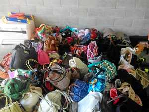 NO BAG DEAL: Just some of the 300 bags donated to charity.