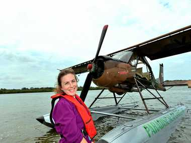 """MAKING A SPLASH: Paradise Seaplanes float plane Willy is """"better than new"""" for the summer season. Tessa Mapstone enjoys one of the flights, taking off on the Maroochy River."""