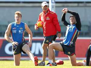 Tom Lynch and Steven May look on during a Gold Coast Suns  training session