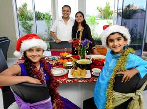 GIVING SPIRIT: Indian Mehfil owner Raj Sharma, pictured with wife Prianka and their children Sara and Sohaan, will feed hundreds of the Ipswich needy on Christmas Day at his Ipswich CBD restaurant for free..