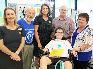 CHARTIABLE ACT: Coming together to bring Samuel home are (from left) Heritage Bank staff member Linda Bloomer, customer Eric Thorne, Heritage staff member Amii Gill, parents Craig and Jane Thorne with Samuel.