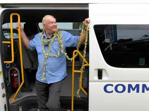 JUMP ON BOARD: Driver for Clarence Community Transport Hank Steeghs getting ready for Christmas lights tours in the Clarence Valley.