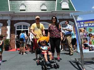 Visitors go through the doors of Dreamworld on the Gold Coast, Saturday, Dec. 10, 2016.
