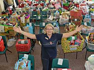GENEROUS: Rosemary Campbell from the Nambour Salvation Army with hampers ready to go out for Christmas.