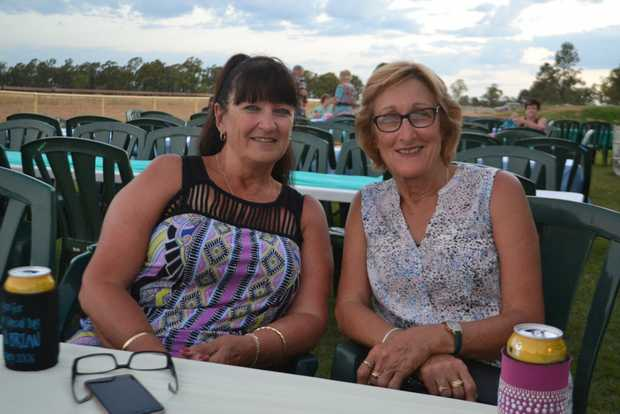 Image for sale: Travelling friends Dawn Fox and Lorraine King from Western Australia at the Miles New Years Eve beach party celebrations. 31/12/16.