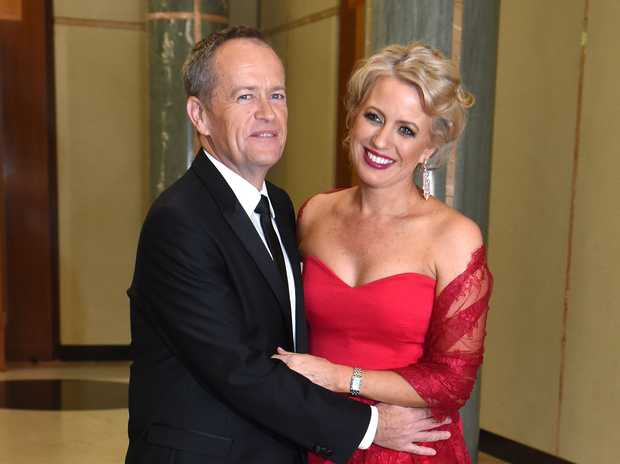 Bill and Chloe Shorten in the entrance to Parliament House. Photo: AAP