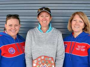 Netball coach Karyn Byrne (centre) with Amelia Sutton and Leanne Olsen after being presented with the Dr Barbara O'Dea Memorial Trophy in 2016.