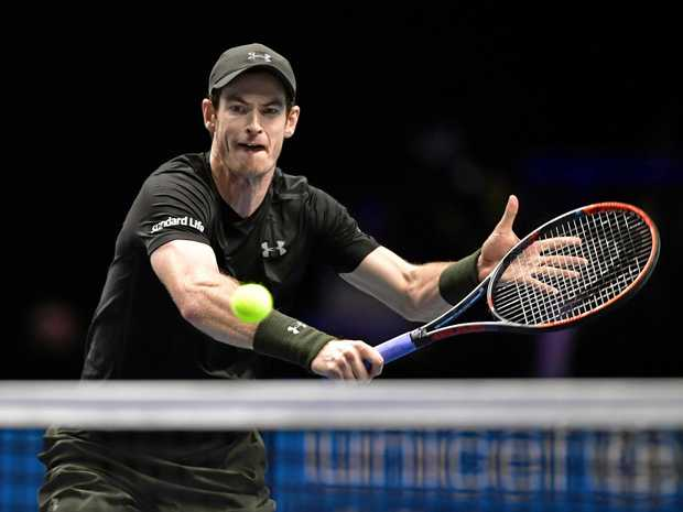 World No. 1 Andy Murray of Britain returns a shot on his way to defeating No. 2 ranked Novak Djokovic of Serbia 6-3, 6-4, in the final of the ATP World Tour Finals in London on Nov. 20, 2016.