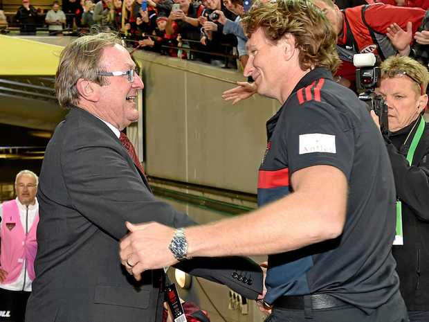 Essendon coach James Hird (right) with former coach Kevin Sheedy in 2015.