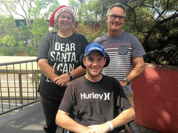 REUNITED: Luke Thornton with his rescuers, Tracy Eglington and Paul Ryan. The train driving pair found Luke after he was involved in a serious car crash outside Chinchilla on July 15, 2016.