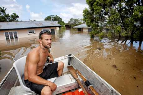 Barry Adams of Woodend used this dingy to help his family move possessions and themselves to higher ground on Leslie Street at East Ipswich.