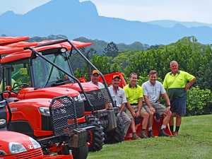 READY TO GO: Tropical Fruit World staff check out the new machinery at the Duranbah property.