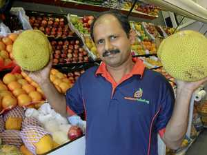 NEW BUSINESS: Southern Fruits and Veg co-owner Varghese Mathew shows off jackfruit available at the store.