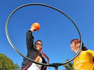 KIDS PLAY QUIDDITCH: Elijah Otasui gets a few tips from regular player Alise Fox.