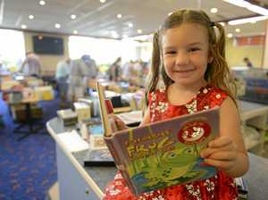 PAGE TURNER: Molly Doust, 4, of Springsure, Queensland, samples one of the free children's books on offer at the Maclean Rotary Club Book Sale on Saturday.