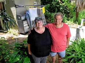 Jo Walker and Kelvin Steinhardt in front of what used to be their back shed. A tree from a neighbouring property fell over during a recent storm and destroyed it.