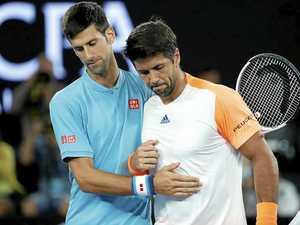 Novak Djokovic (left) of Serbia thanks Fernando Verdasco of Spain after their first-round match at the Australian Open.