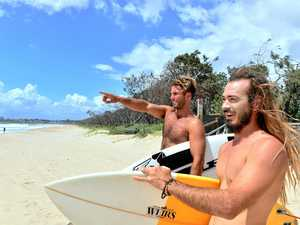 ALWAYS READ THE OCEAN: Josh Sherwell and Andy Lister check the surf at Maroochydore.