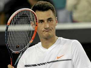 Australia's Bernard Tomic reacts after defeating Dominican Republic's Victor Estrella Burgos in their second round match at the Australian Open.