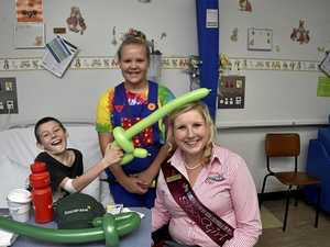 SHOW FUN: Putting a smile on young Toowoomba Hospital patient Jordon Davies' face is clown Brianna Byrd (centre) and Miss Darling downs Showgirl 2016 Annie Fulton.