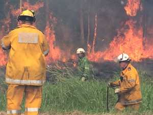 PHOTOS: Firefighters battle large bushfire at Coolum