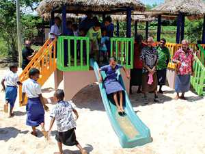 The new playground behind the new kindergarten and, top right, the new meeting bure and, right, Conua District schoolkids at the opening of the kindy.