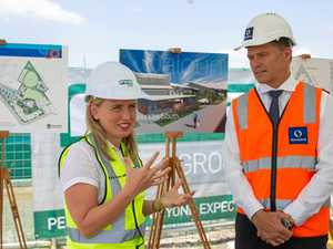 UNDERWAY: Kate Jones, MP (L) and Stockland's Kingsley Andrew at the sod turning.