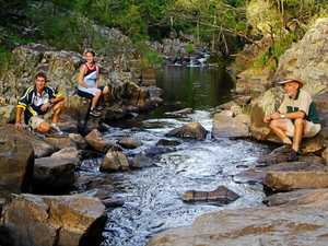 CARE: Kristian Johnson, Kristen Freegard and Chris Ayre at Broken River. The swimming hole is officially open, but Queensland Parks and Wildlife Service warns the water is unsafe due to fluctuating nutrient and pathogen levels.