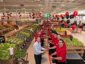 OPENING: The new Coles at Sippy Downs is now open for business. Kawana MP Jarrod Bleijie joins staff to cut the ribbon.