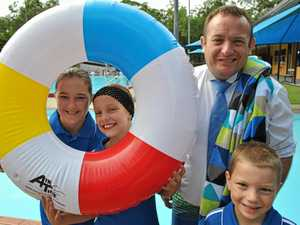 Division 12 Councillor Adrian Raedel with members of the Woodford Swim Club.Photo Contributed