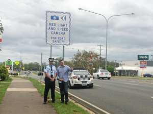 NEW CAMERA: Minister for Police and State Member for Morayfield Mark Ryan and Assistant Commissioner Mike Keating in Morayfield inspect the location where the new red light camera will be.