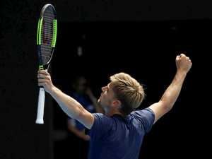 David Goffin reacts after winning against Dominic Thiem of Austria during round four