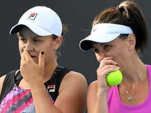 Ashleigh Barty (left) and Casey Dellacqua in action during the Australian Open women's doubles.