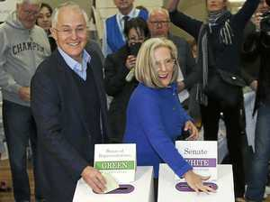 Australian Prime Minister Malcolm Turnbull, left, and wife Lucy cast their votes in the federal election at the Double Bay public school in Sydney, Australia, Saturday, July 2, 2016. After years of political turmoil, Australians headed to the polls on Saturday with leaders of the nation's major parties each promising to bring stability to a government that has long been mired in chaos. (AP Photo/Rob Griffith)