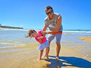 SWIM SAFE: Duncan Kennedy with his daughter Ava, 3. Duncan said to check the sand for washed up jellyfish before going swimming.