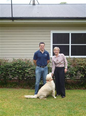 "Infinity Solar's Mark Delaney, Mrs Johnson and Bonnie the dog - with ""Solar Central"" atop!"