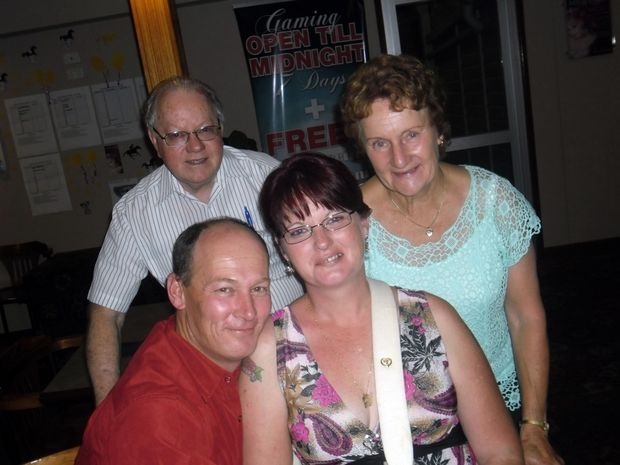 Valerie and John O'Hara (back) with Shane andTina Mullins at their 11th wedding anniversary dinner in October 2012.