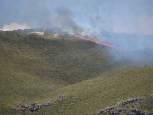 Fire burns on Mount Coolum