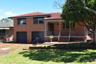 Fancy a weekend stroll to Picnic Point with the family?  This split level brick home is perfectly lo...