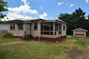 This timber home on stumps with VJ walls and iron roof is located in popular Newtown and is located...