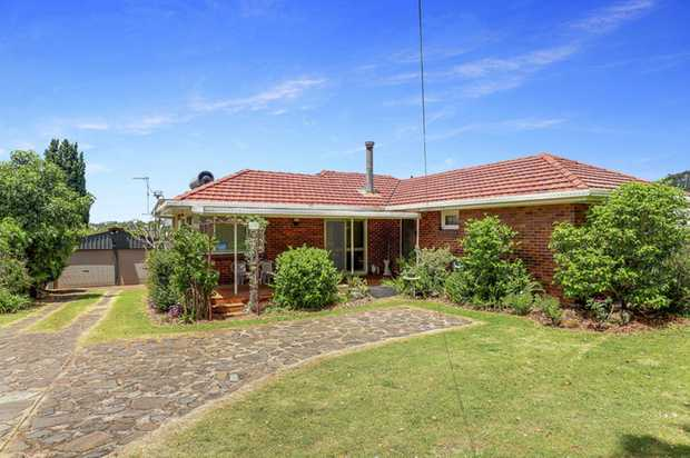 Brick and tile home in impressive and sought after South Toowoomba location, within walking distance...